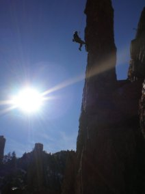 Erik Thatcher raps off a pillar in the Poudre Canyon, CO. PC: Bruce Althouse