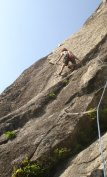 Adam Bofinger in the crux of the Beast Flake