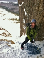 It takes a great climbing partner to take an ice tool to the face and still have a smile like that at the next belay. Paul Pellesier on the Black Dike