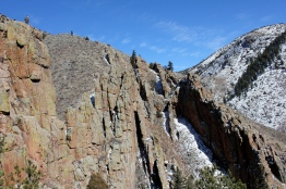 Bruce Althouse stands atop a climb at the Pages, in the Poudre Canyon