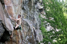 Adam Patridge moving onto the slab on Rap Echo (5.12b) at Main Cliff