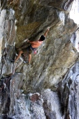 Tim Greene on the opening move of Dyno- Sore's crux (5.13a)