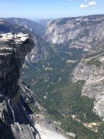 Paul hanging out on top of Half Dome