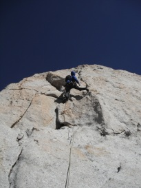 Erik on some exposed face climbing high up on Cathedral Peak, Tuolumne Meadows