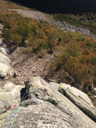 Sport climber on crack. Fresh rock fall DZ on the left