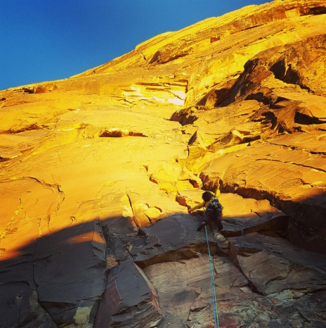 Erik starting into the alpenglow on P1 of Levitation 29 -PC: James Otey
