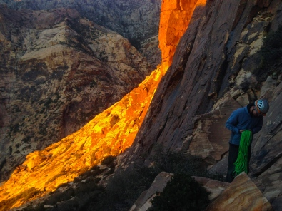 James flaking rope for Levitation 29 as the alpenglow stretches across the cliff